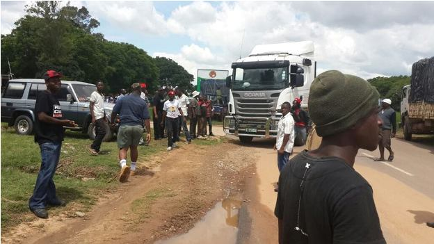 UPND cadres gaurding the trucks they impounded