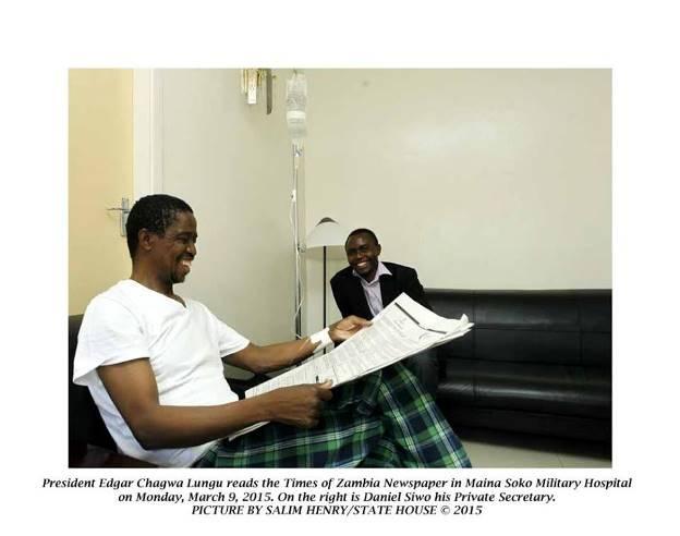 Lungu reading Newspaper