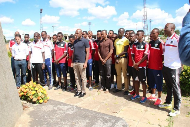 """The Rwanda National Soccer team at the burial site for the Zambia National Soccer team players that perished in what has come to be called the """"Gabon Disaster"""""""