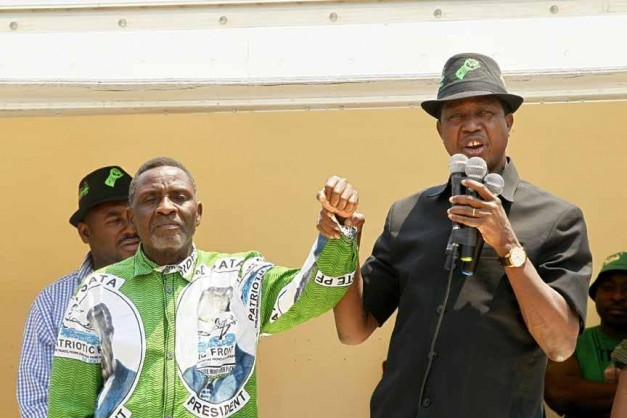 resident Edgar Chagwa Lungu (right) introduces George Mwamba, the Patriotic Front(PF) Candidate for Lubansenshi Constituency to electorates