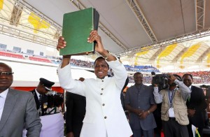 President Lungu lifts the new constitution after assenting the bills