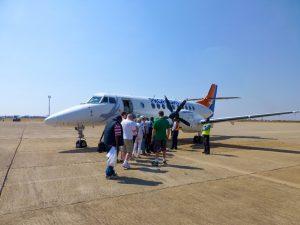 Tourists preparing to board a Proflight Zambia flight at Kenneth Kaunda International Airport