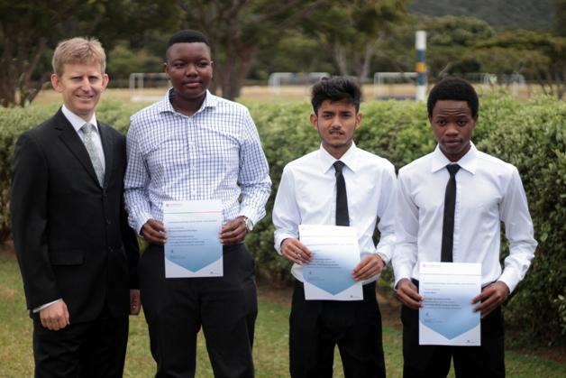 Principal Andrew Cowling with Munashe, Karan and Dalitso