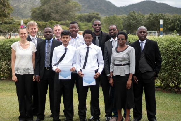 Mkushi District Education Standards Officer, Ms Eness Shooba (front row, far right) andChingelo Principal Andrew Cowling (last row, far left) with Karan, Munashe, Dalitso and their teachers