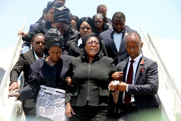 Mulenga Sata (R) with his Stepmother coming out of the plan accompaning the body of Sata