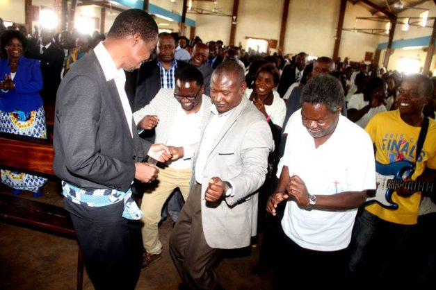 President Lungu dancing with Frank Bwalya in Church