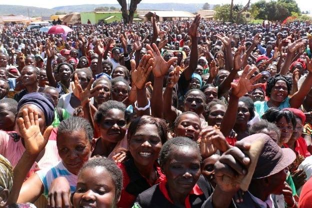 Hichilema shares a light moment with his running mate Geoffrey Mwamba
