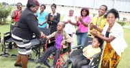 Special Olympics Zambia delivers wheelchairs and food hampers