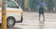 Police woman who braved rains promoted