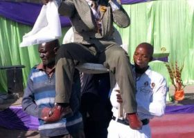 Pastors orders members to carry him during service